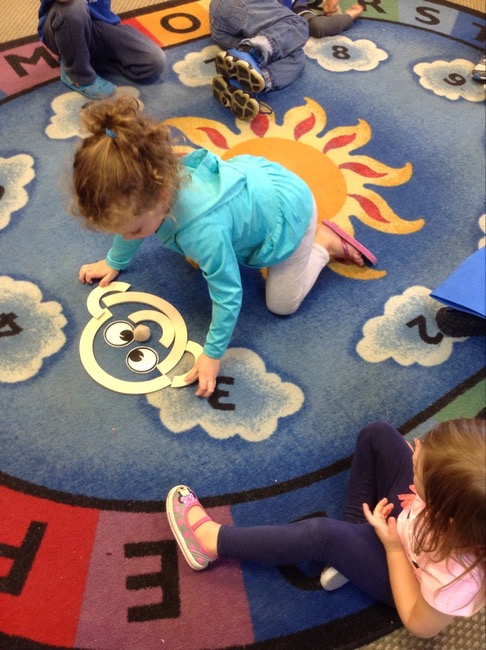 child playing on carpet with toys in syracuse daycare